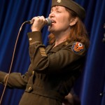 Dina Blade sings in a WW II uniform